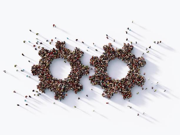 Menschliche Menschenmenge formt zwei Gear-Symbole – Foto