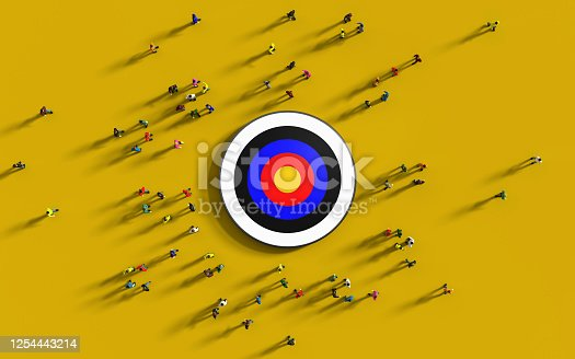 935757718 istock photo Human Crowd Gathering Around A Red Bulls Eye Against Yellow Background 1254443214