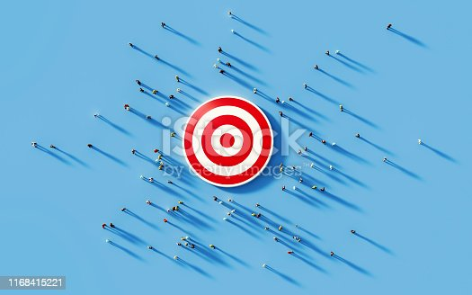 Human crowd gathering around a red bulls eye on blue background. Horizontal composition with copy space. Clipping path is included. Marketing and target audience concept