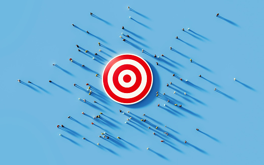 istock Human Crowd Gathering Around A Red Bulls Eye: Marketing and Target Audience Concept 1168415221