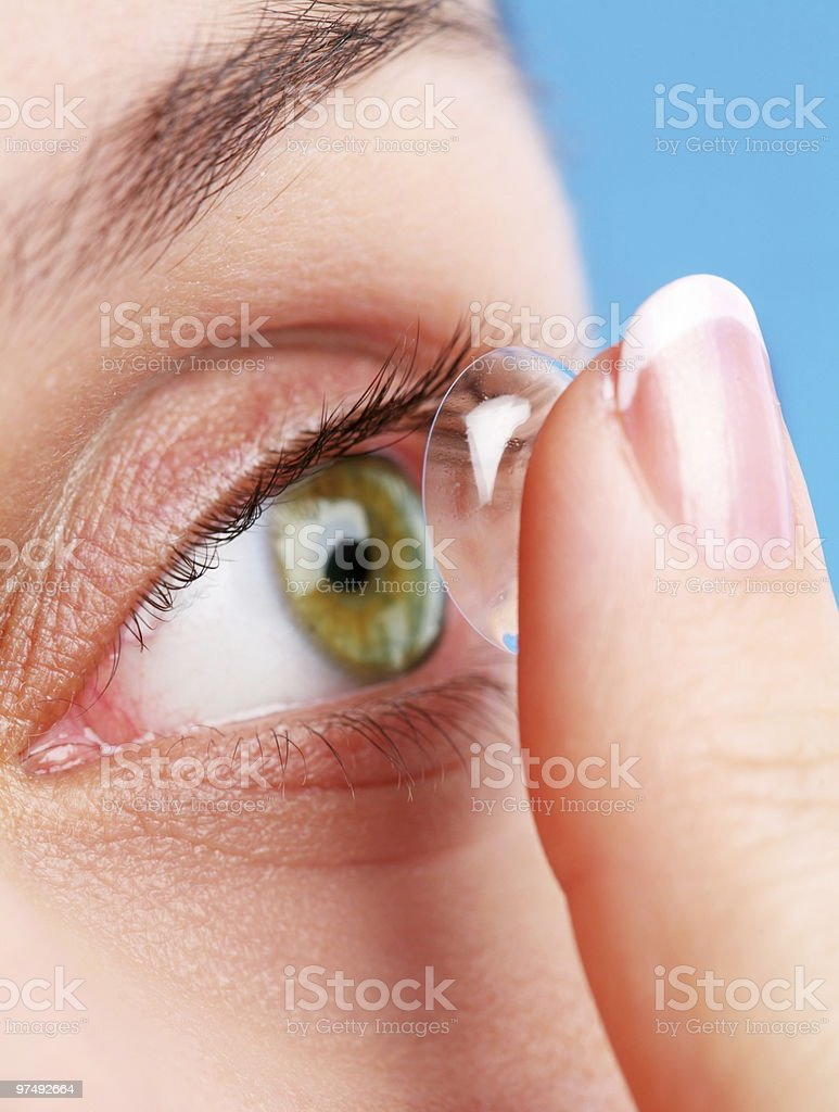 human eye with corrective lens on a blue royalty-free stock photo