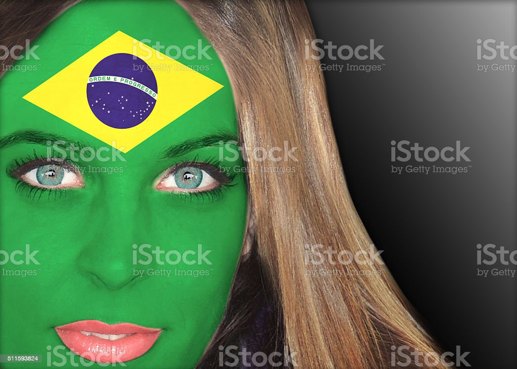 Human face painted with flag of Brazil stock photo