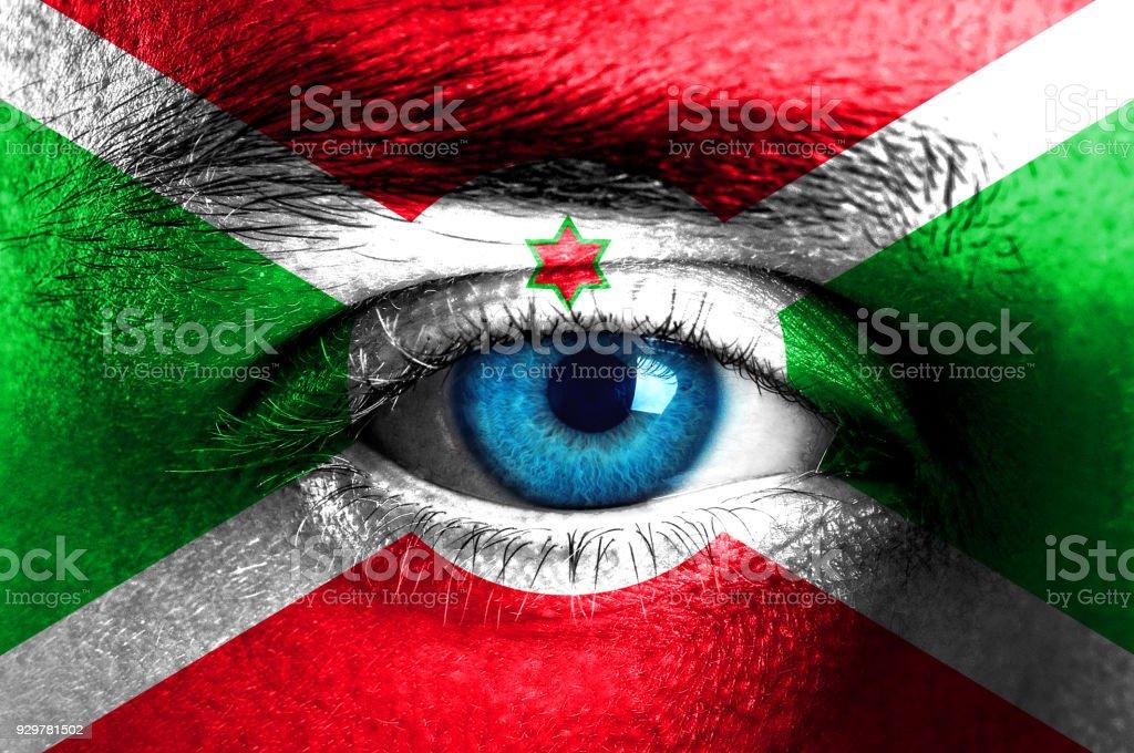 Human face painted with flag of Burundi stock photo