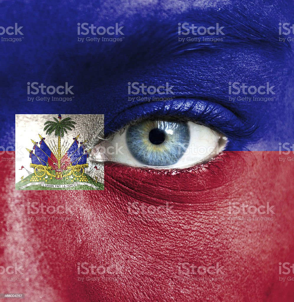 Human face painted with flag of Haiti stock photo