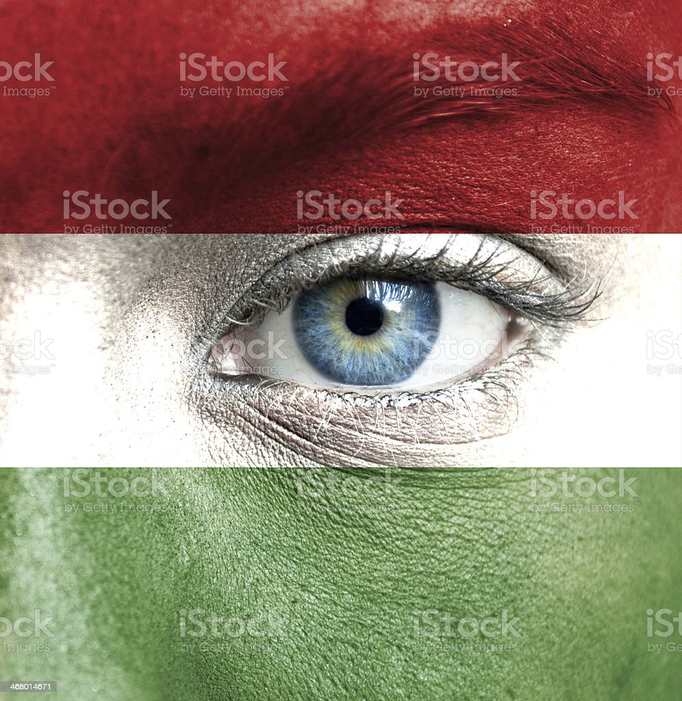 Human face painted with flag of Hungary stock photo