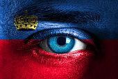 Human face painted with flag of Liechtenstein