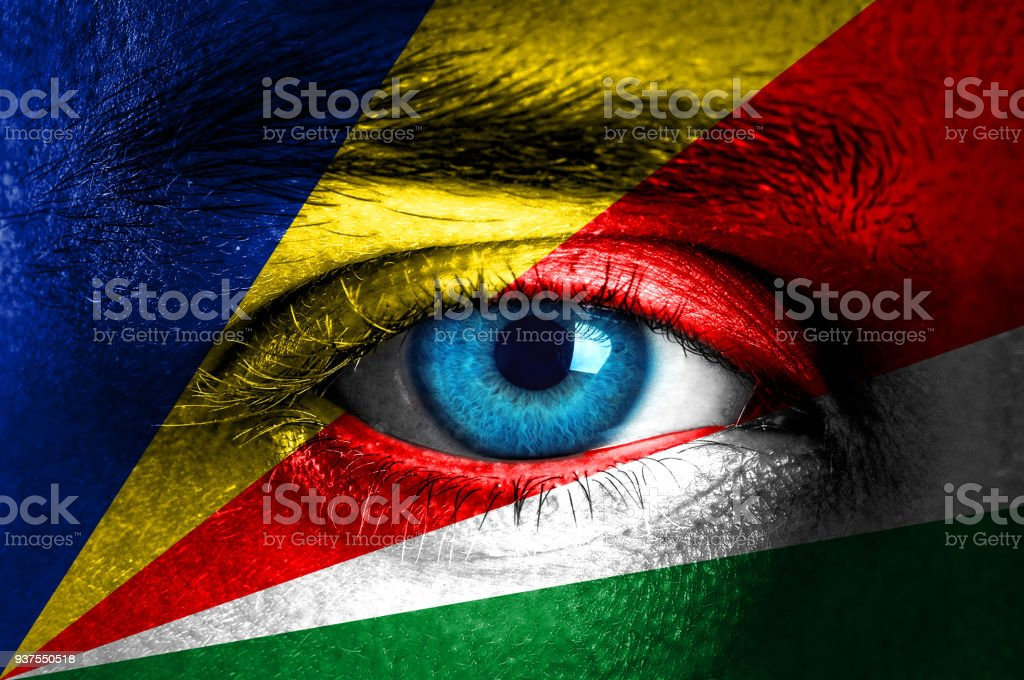Human face painted with flag of Seychelles stock photo