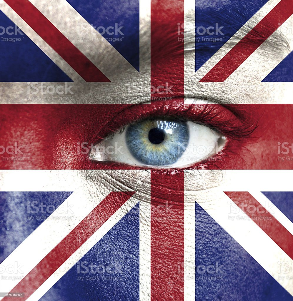 Human face painted with flag of United Kingdom stock photo