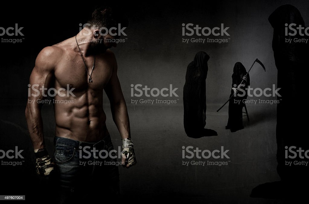 human fighter versus death stock photo