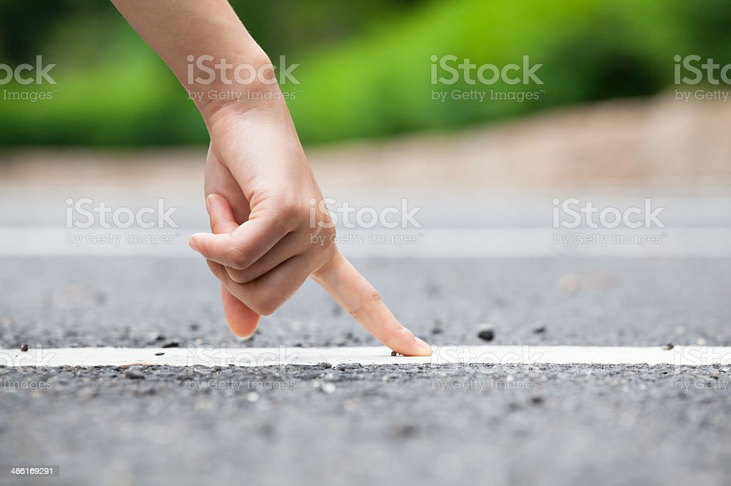 Human Finger Touching Road stock photo