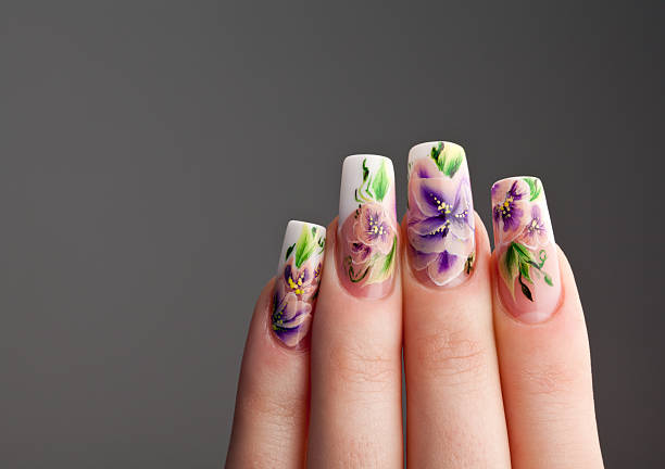 Human fingers with beautiful spring manicure stock photo