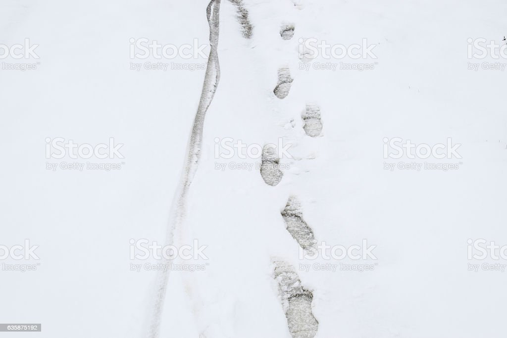 Human footprints in the snow stock photo
