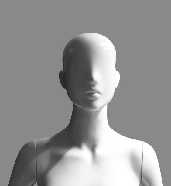 human form female mannequin isolated on gray background human female mannequin portrait photograph with light and shadow effects isolated on grey background retail equipment stock pictures, royalty-free photos & images
