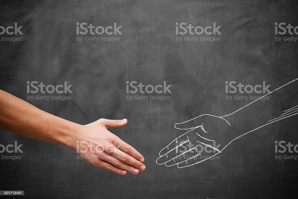 Human hand and chalk drawing of a hand stock photo