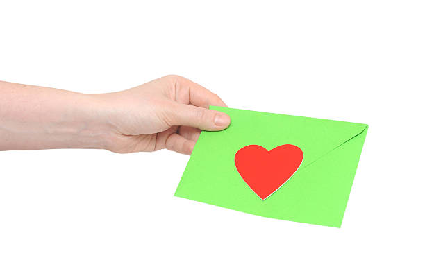 human hand and love letter on white background stock photo