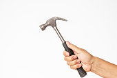 male hand holding a hammer isolated on a white background