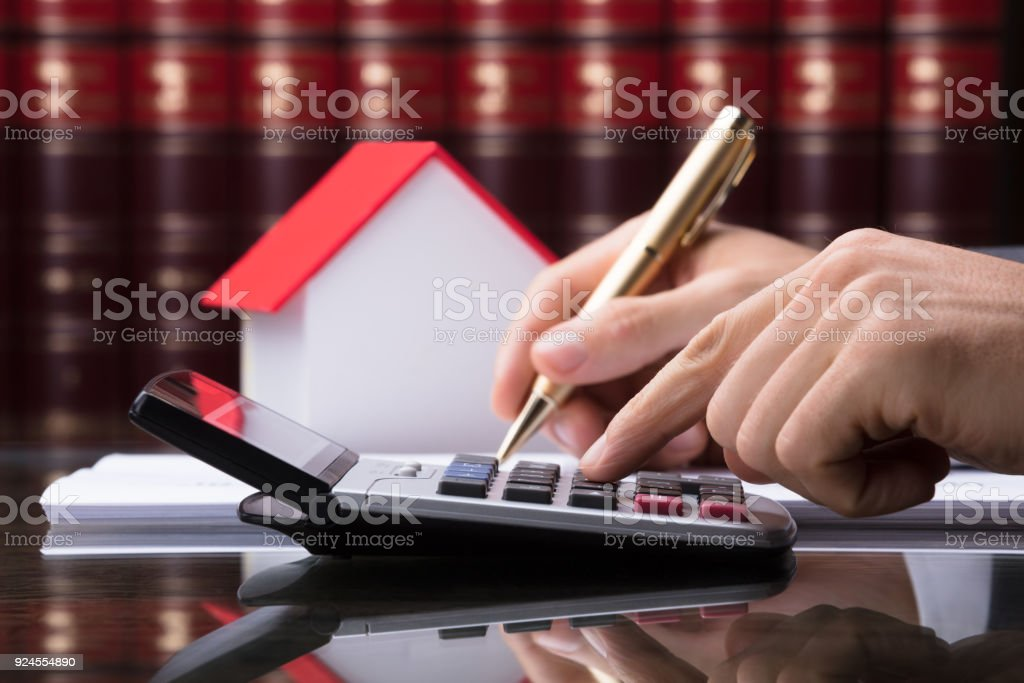 Human Hand Calculating Tax stock photo