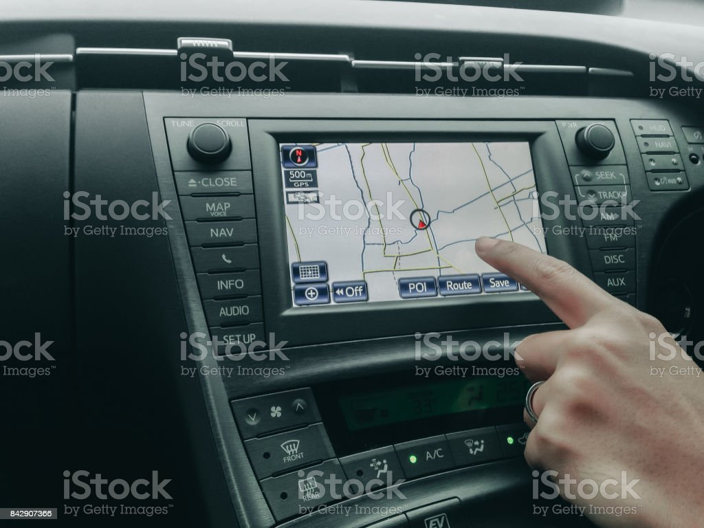 human hand control and point to car moniyor display with GPS navigator with interior design in luxury car stock photo