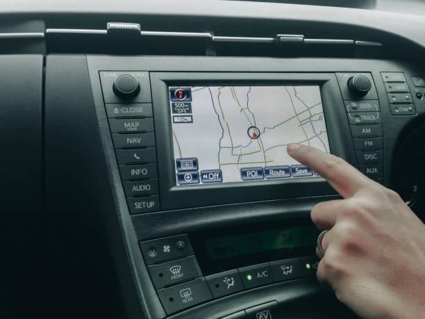 human hand control and point to car moniyor display with GPS navigator with interior design in luxury car human hand control and point to car moniyor display with GPS navigator with interior design in luxury car global positioning system stock pictures, royalty-free photos & images