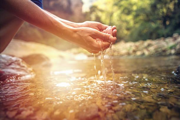 Human hand cupped to catch fresh water from river picture id638079536?b=1&k=6&m=638079536&s=612x612&w=0&h=x2jfjpqjlfwedu91ycrozs d27e9tx9opph zmrctnk=