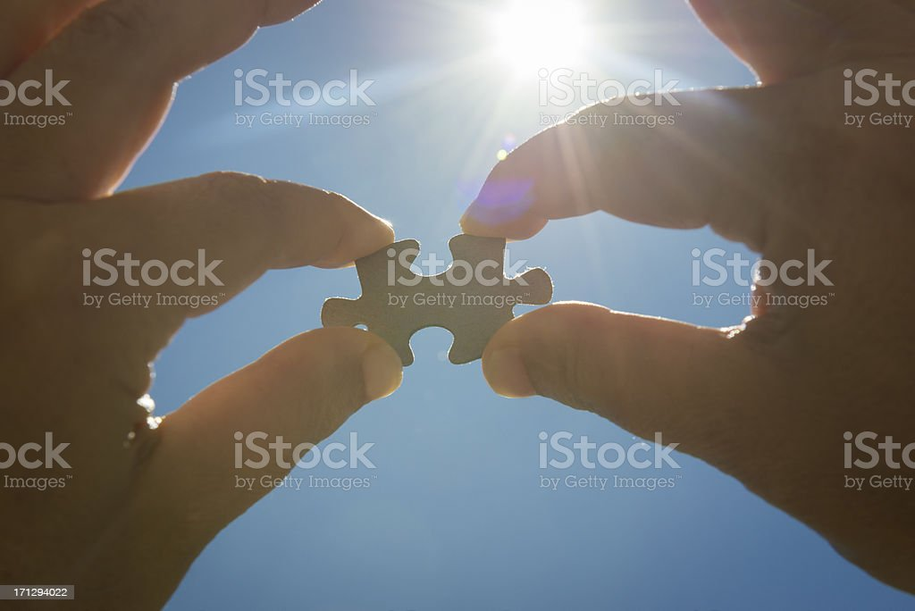 human hand doing a puzzle connection royalty-free stock photo