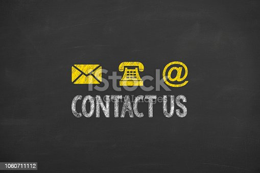 istock Human Hand Drawing Contact Us on Blackboard 1060711112