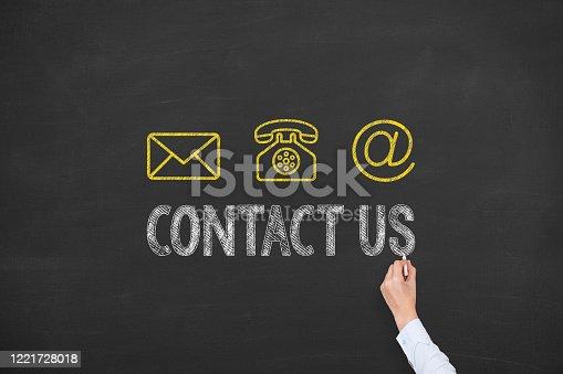 istock Human Hand Drawing Contact Us on Blackboard 1221728018