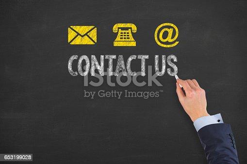 istock Human Hand Drawing Contact Us on Blackboard 653199028