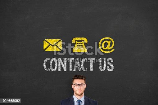 istock Human Hand Drawing Contact Us on Blackboard 924668092