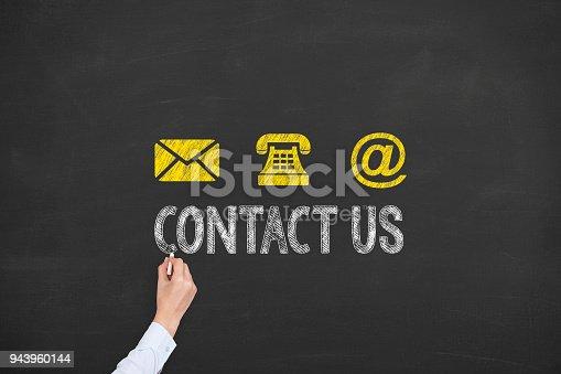 istock Human Hand Drawing Contact Us on Blackboard 943960144