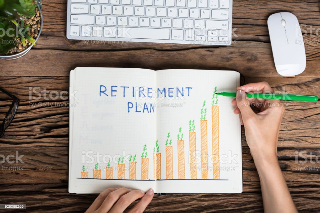 Human Hand Drawing Retirement Plan Growth Concept stock photo