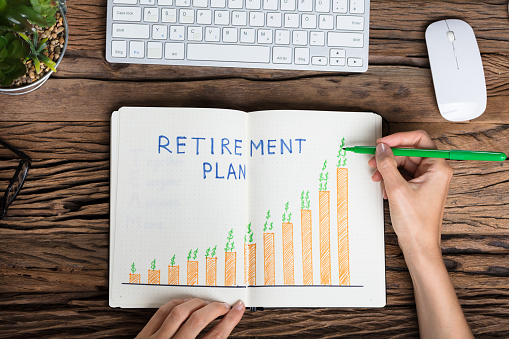 Human Hand Drawing Retirement Plan Growth Concept Stock Photo - Download Image Now
