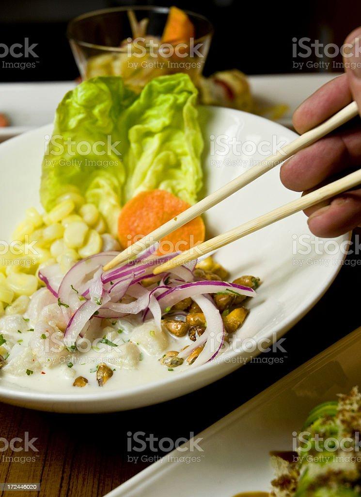 Human Hand Eating An Asian Salad  With Chopstix royalty-free stock photo