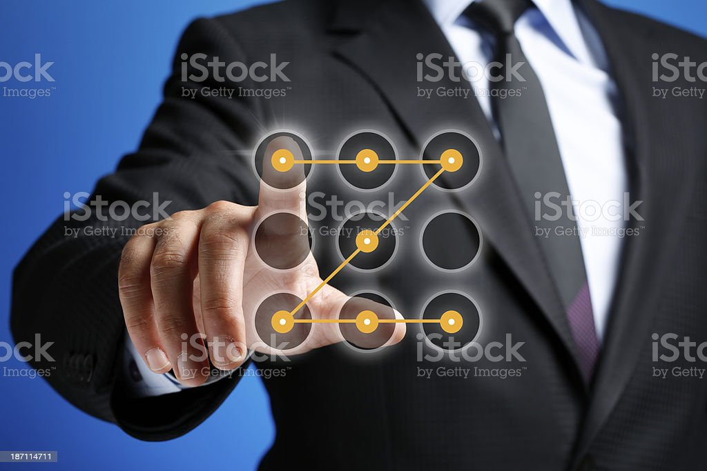 Human Hand Entering Password on Touch Screen stock photo