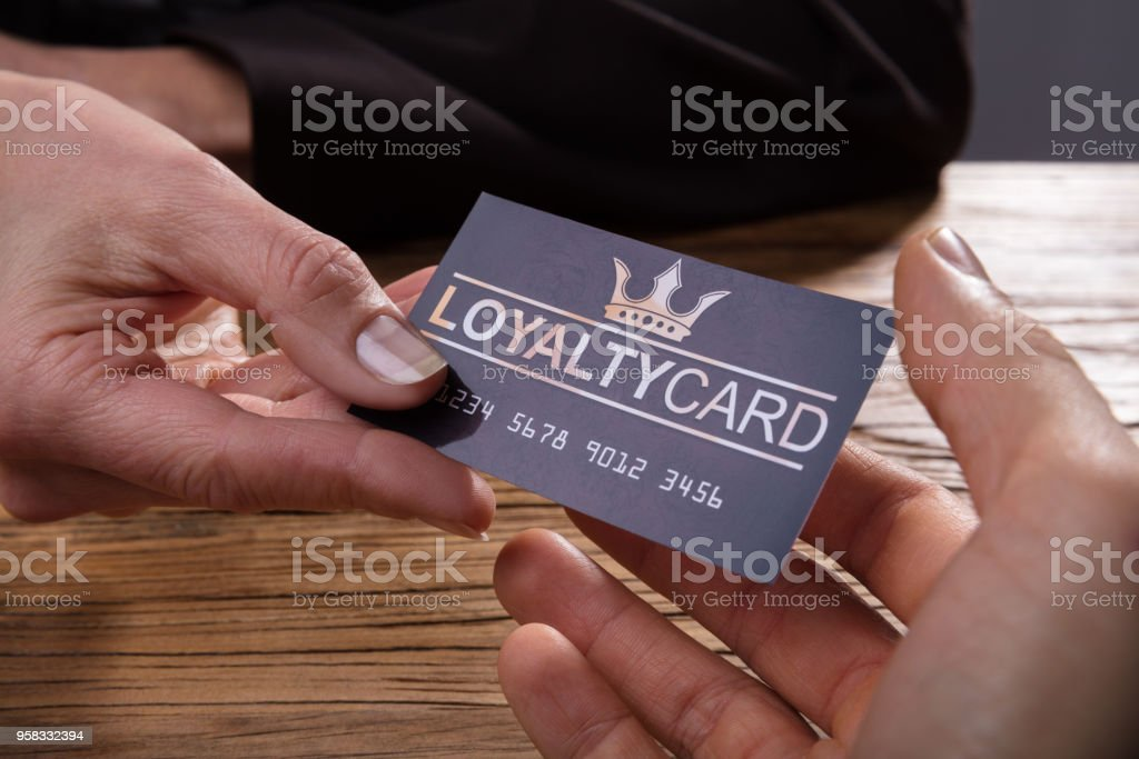 Human Hand Giving Loyalty Card To Another Person stock photo