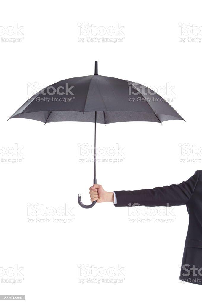 human hand holding a black umbrella stock photo