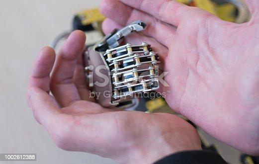 istock Human hand holding a robot hand 1002612388