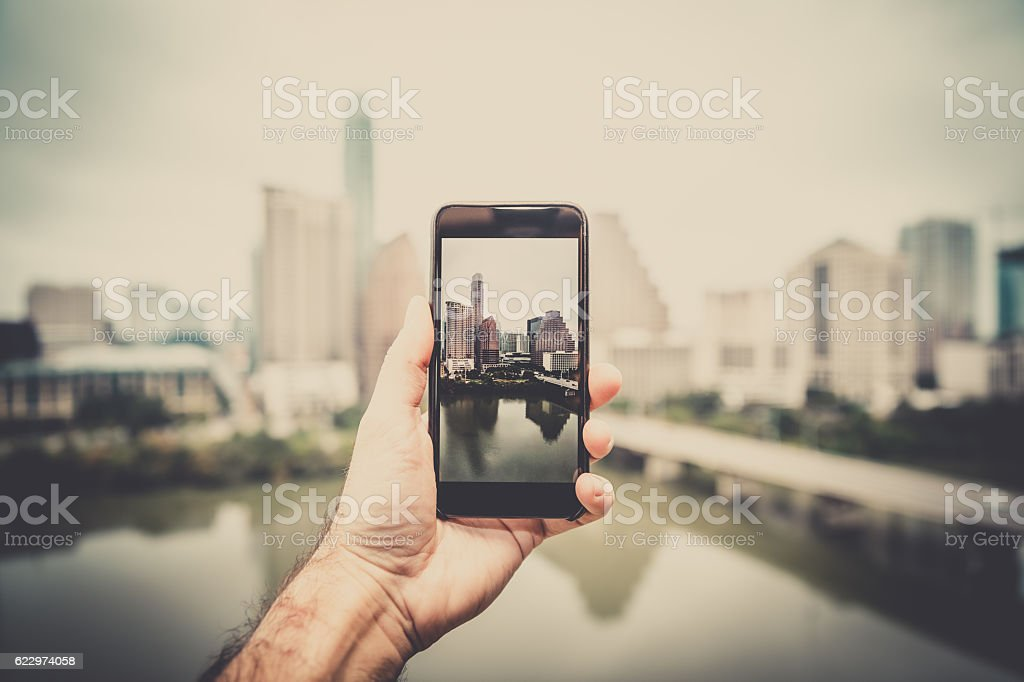 Human Hand Holding a Smart Phone in Austin Texas stock photo