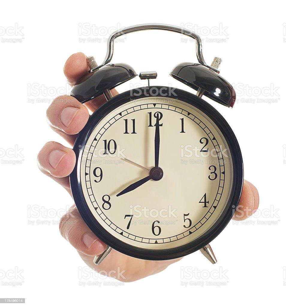 Human Hand Holding Alarm Clock royalty-free stock photo