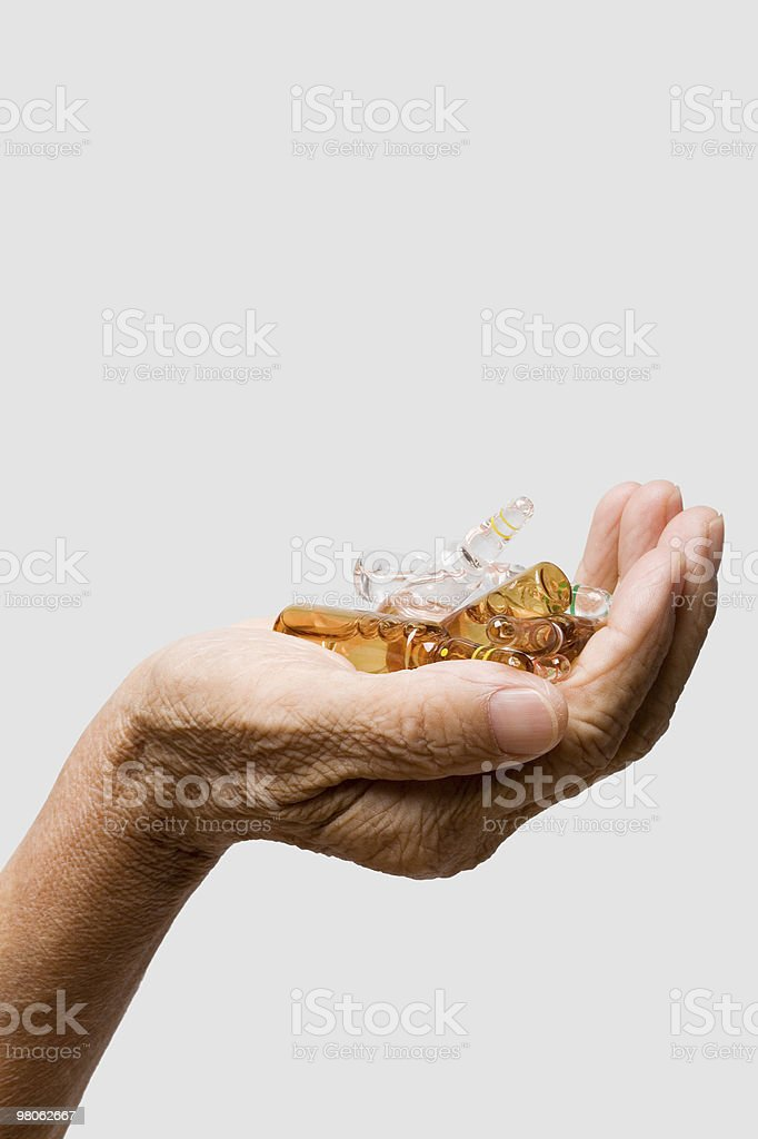 Human hand holding ampules royalty-free stock photo