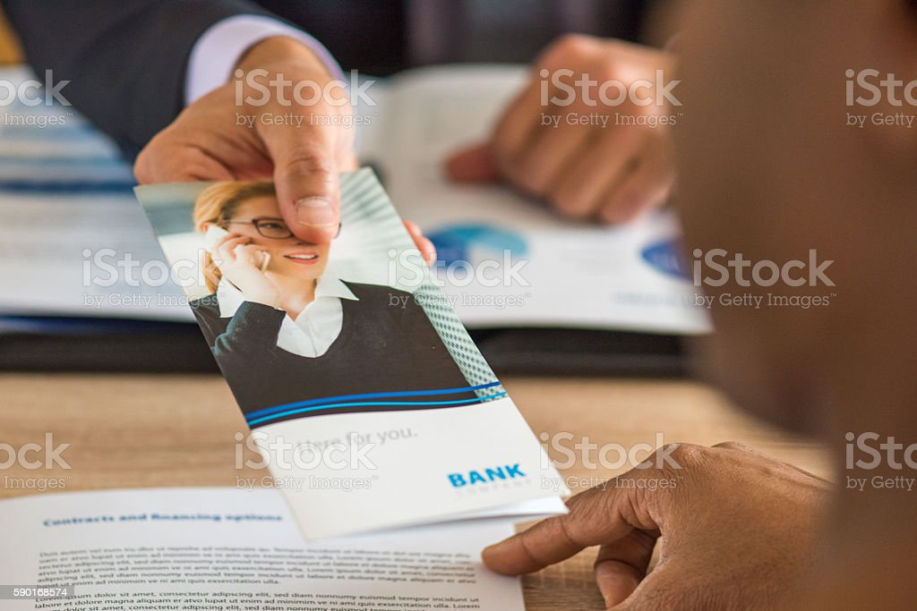 Human hand holding brochure stock photo