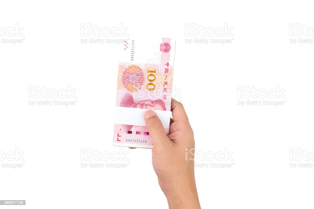 Human hand holding Chinese yuan banknotes isolated on white background. stock photo