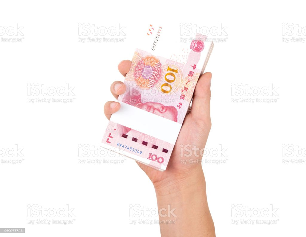 Human hand holding Chinese yuan banknotes isolated on white background with clipping path. stock photo