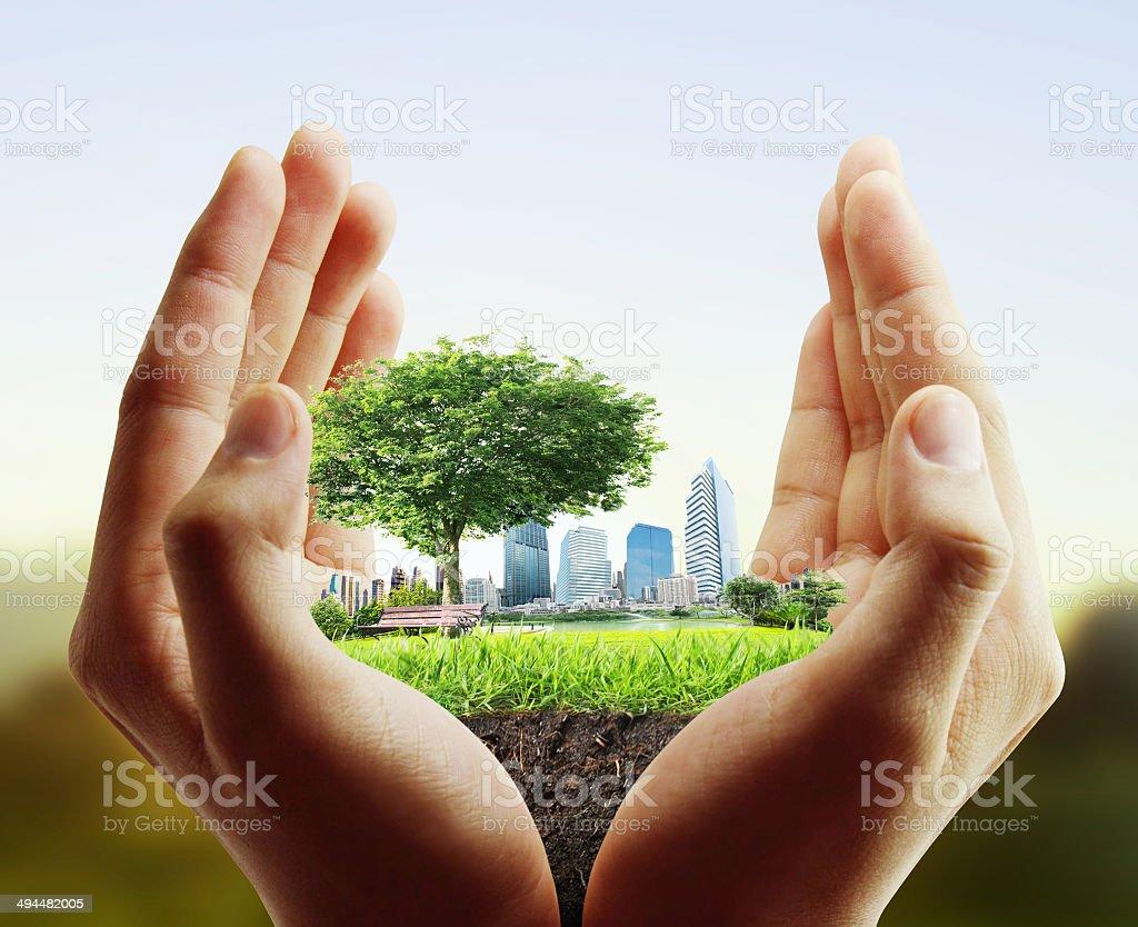 human hand holding  city stock photo