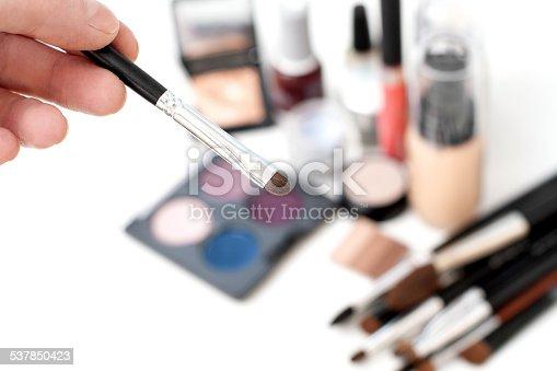 istock Human hand holding makeup brush 537850423