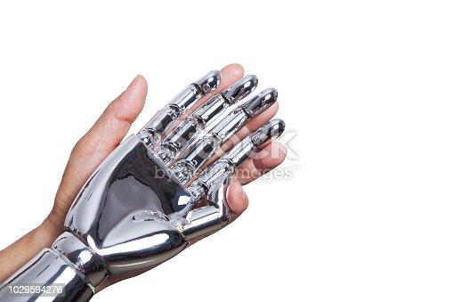 istock Human hand holding robotic hand 1029594276