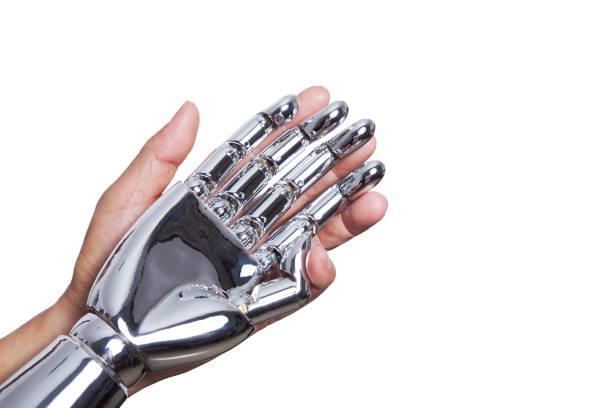 Human hand holding robotic hand Human hand holding robotic hand prosthetic hand stock pictures, royalty-free photos & images