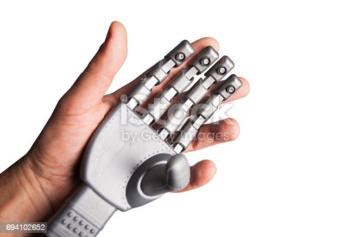 istock human hand holding robotic hand 694102652