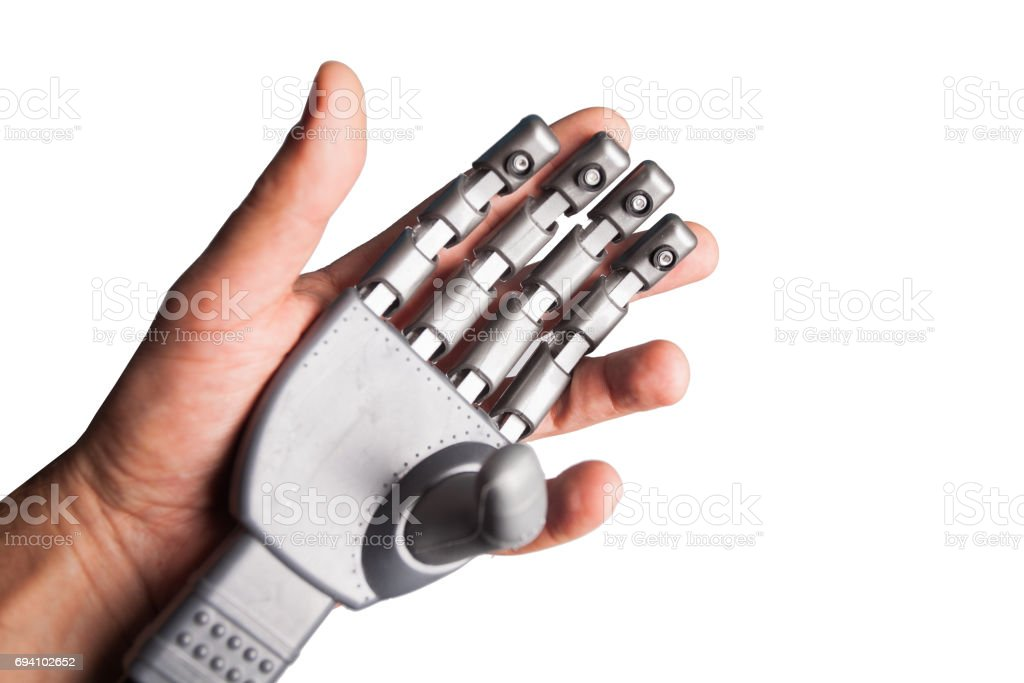 human hand holding robotic hand stock photo