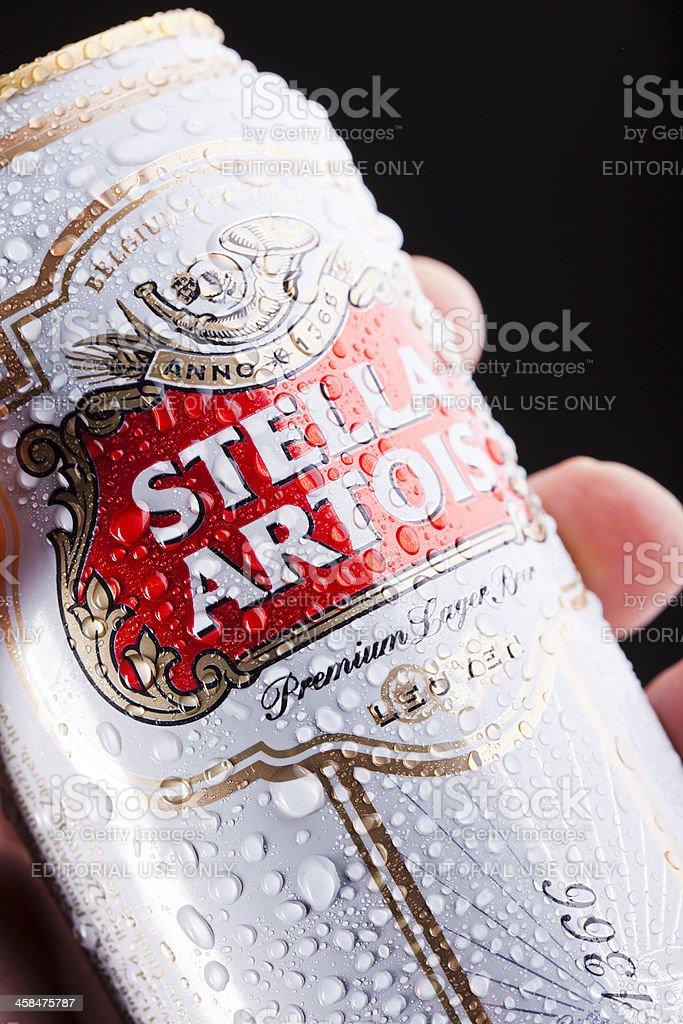 Human hand holding Stella Artois beer can stock photo